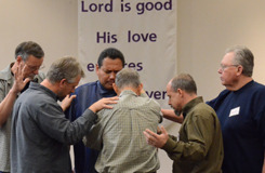 Elders and Frank Tyndall in prayer